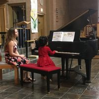 indv-piano.-lesson-girl-red